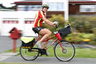 Postie Hildeke Witteveen pictured on her daily round in Albany. Up to 2000 jobs - including posties -  are set to go from NZ Post in the next five years. File photo / Chris Gorman