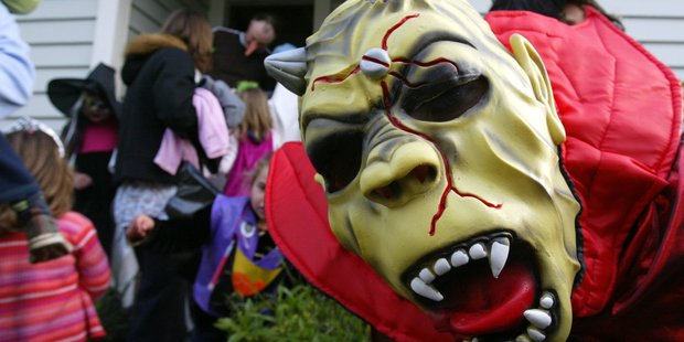 Children traditionally get dressed in scary get-ups and head out to disturb their suburb and score a few special treats in the process. Photo / Dean Purcell