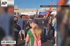 Amateur video shows evacuated passengers at Los Angeles International Airport stranded on the tarmac and inside the airport after a shooting forced police to shut down the airport.
