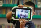 Dux Onelei, 5, with a LeapPad, a digital learning tool that is being used at Colwill Primary in Massey to teach children to write. Photo / Greg Bowker