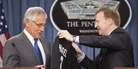 US Defense Secretary Chuck Hagel (L) receives an All Blacks rugby jersey from New Zealand Defense Minister Jonathan Coleman (R) during a press conference at the Pentagon in Washington, DC. Photo / AFP