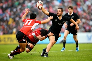Most of the Japan team were giving away height and weight to Dane Coles and the rest of their All Black opposites in last night's test in Tokyo. Photo / Getty Images