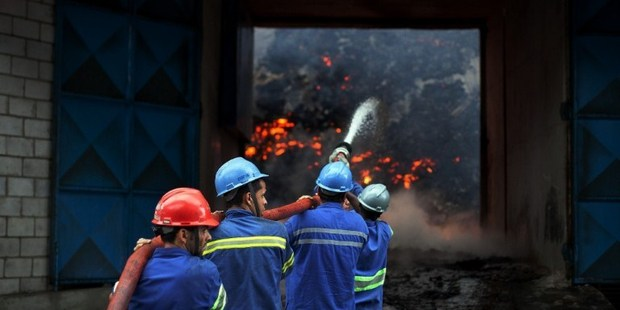 Firefighters attempt to extinguish a fire in a warehouse with sugar at the port of Santos, near Sao Paulo, Brazil. Photo / AFP