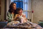 Lili Taylor and Joey King in true-story horror film The Conjuring.