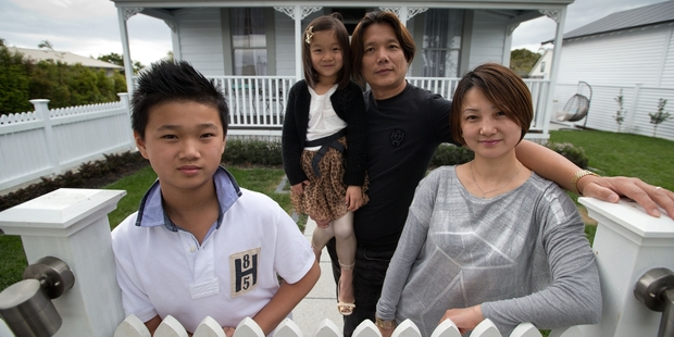Stella Shen - above with husband Alex Shi and children  Aaron  and Katie - chose the house for her sister and brother-in-law. Photo / Richard Robinson