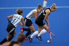 Stacey Michelsen (Black Sticks) breaks past two Argentina players in the Four Nations final.