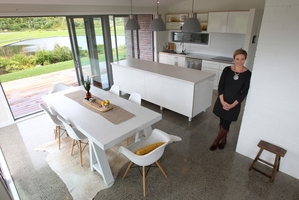 FOLLOWING THE TREND: Lisa Buck of The Thorne Group said styles seen on TV shows such as glossy white kitchens and wood-look floors were popular in Tauranga.PHOTO/JOHN BORREN