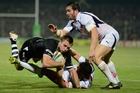Kieran Foran gets tackled during the Kiwis' match against France. Photo / Getty Images