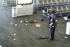 Police officers stand near an unidentified weapon in Terminal 3 of the Los Angeles International Airport. Photo / AP