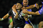 Bryson Goodwin is tackled by Suaia Matagi and Sauaso Sue of Samoa. Photo / Getty Images