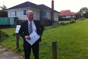 Housing Minister Nick Smith at the site where some of the proposed houses this afternoon. Photo / Heather McCracken