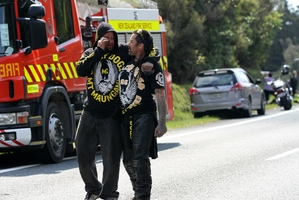 The scene soon after a motorcyclist was killed and others injured near Fitzgerald Glade near Rotorua yesterday. Photo / SNPA