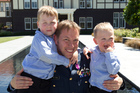 Squadron Leader Ben Pryor with his sons, Hamish, aged 4, and Craig, 2, after receiving the New Zealand Gallantry Medal at Government House, Wellington. Photo / Mark Mitchell