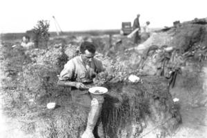 Gallipoli VC winner Cyril Bassett enjoys breakfast on the Western Front in August 1918.