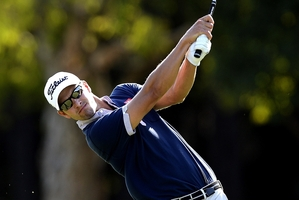 Adam Scott leads going into the final round at Royal Pines today. Photo / Getty Images