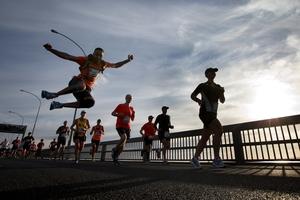 Competitors run over the Auckland Harbour Bridge. Photo / Brett Phibbs