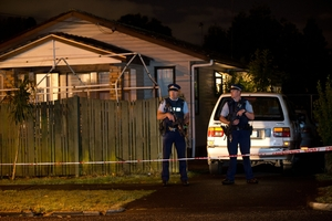 The Yates Rd property where three officers were set upon was kept under guard last night. Picture / Richard Robinson