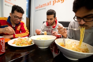 Mosab Askar (left), with brother Abdullah and Khalid Alisha, says he eats more in NZ. Photo / Richard Robinson
