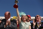 Trainer Gai Waterhouse holds up the Melbourne Cup after winning with Fiorente  at Flemington. Photo / Getty Images