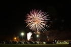 Fireworks are let off, lighting up the skies throughout Tauranga, at this year's Baypark Speedway Fireworks Evening. Photo / Christian Froelich