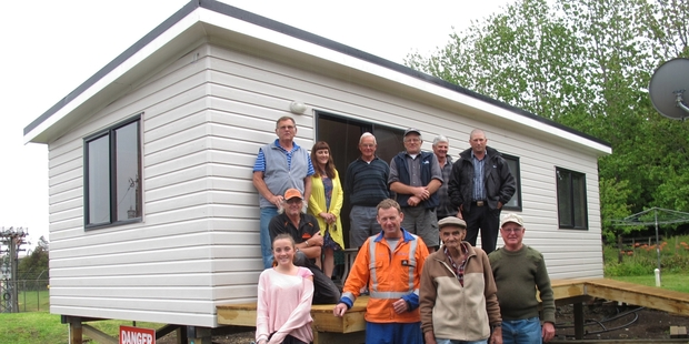 Don Speake (front centre) with his new home and helpers. Photo / Peter De Graaf