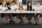 Jessica Lasenby (left), 15, Elekis Poblete Teirney, 16, Sarah Taylor, 15, Ana Davies, 15, Jackson Preston, 17, Mount Maunganui College students, are preparing for the NCEA exams that start on Friday. Photo / Joel Ford
