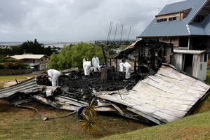 RAZED: A house which police suspect was being used as a meth lab at Mangawhai Heads was destroyed in a fire. PHOTO/MICHAEL CUNNINGHAM