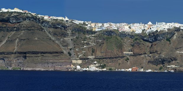 From a distance, the cluster of pure white buildings on the rim of Santorini's volcanic caldera looks like a coating of fresh snow. Photo / Justine Tyerman