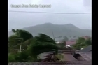 One of the most intense typhoons ever recorded has torn into the Philippines, triggering flash floods and ripping down buildings as millions of people huddle indoors.