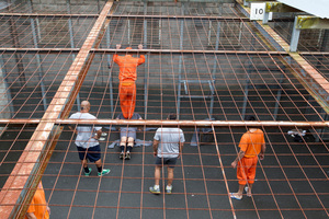 Waikeria inmates help each other train in the high security unit exercise yard. Photo / Michael Craig