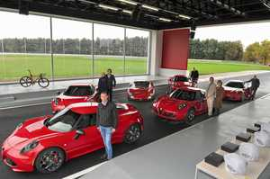The first customers pick up their Alfa Romeo 4Cs at the company's test track in Balocco, Italy.