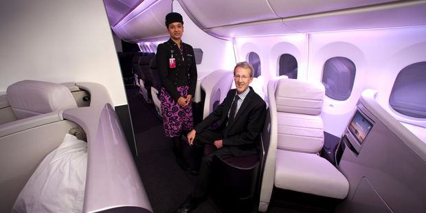 Air New Zealand programme director Kerry Reeves with in flight service manager Priyanka Girish inside the model of the new Air New Zealand Boeing 787 Dreamliner. Photo / Dean Purcell