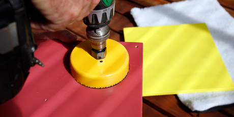 Use hole saw to cut play holes. Photo / Michael Craig
