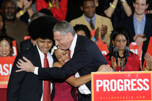 Mayor-elect Bill de Blasio embraces his son Dante, left, and daughter Chiara, center, after he was elected the first Democratic mayor of New York City in 20 years.