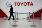 An employee of Toyota Motor Corp. prepares for an event at Mega Web, a renewed Toyota gallery in Tokyo. Photo / AP