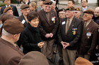 South Korea's President Park Geun-hye, center, talks to Belgian Korea veterans after a wreath-laying ceremony at a Korea war memorial in Brussels. Photo / AP