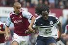 West Ham's Winston Reid, left, fights for the ball with Everton's Romelu Lukaku. Photo / AP