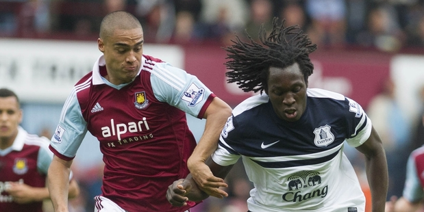 West Ham's Winston Reid, left, fights for the ball with Everton's Romelu Lukaku. Photo / AP