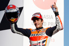 Marc Marquez  celebrates on the podium after finishing second in the MotoGP Japanese Grand Prix.Photo / AP