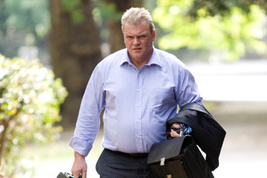 Former Bridgecorp director Robert Roest arrives at the Auckland High Court.