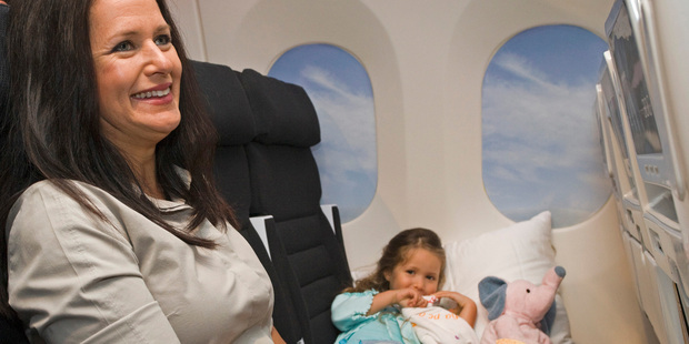 Ke'ala Campton Baker, left, and Tatairangi Baker sample the economy skycouch. Air NZ has now made its first sale of the idea to an unnamed Asian airline. Photo / NZPA