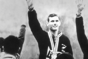 Peter Snell celebrates his 1500m gold at the Tokyo Olympics in 1964. (NZ Herald Archive)