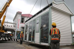 Contractors lower Greytown's new public toilets into position on the main street.