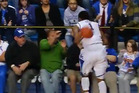 This stunning clip came from a college basketball game in the USA where Kentucky power forward James Young scored the most improbable of baskets. Photo / YouTube.