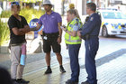 Police and City Assist guardians speak to a young person in the Hastings CBD after an altercation. Photo / Glenn Taylor