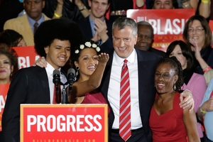 Bill de Blasio poses with son Dante, daughter Chiara and wife Chirlane after he was elected the first Democratic Mayor of New York City in 20 years. Photo / AP