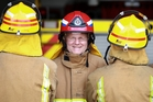 BOLD: Mount Maunganui fire service station officer Terry Mills stands out with his new red helmet.PHOTO/JOHN BORREN 081113JB09BOP