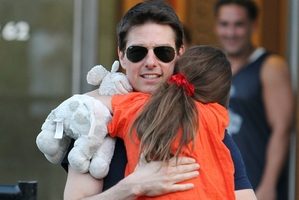 Tom Cruise says claims that he has cut Suri from his life are absurd. Photo / AP