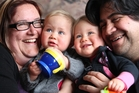 Rachel Sharp and Jason Wainohu with twins Isabella (left) and Dilana. Photo Ben Fraser