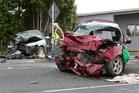 A kaumatua blesses the scene where two people died in a crash between Kamo and Hikurangi on Saturday.